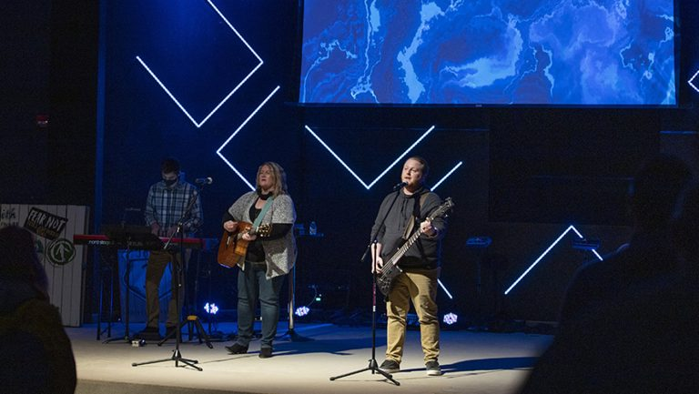 Band leading worship on stage