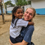 Northpointe member holding a child in her arms