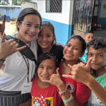 Students in Ecuador smiling for the photo