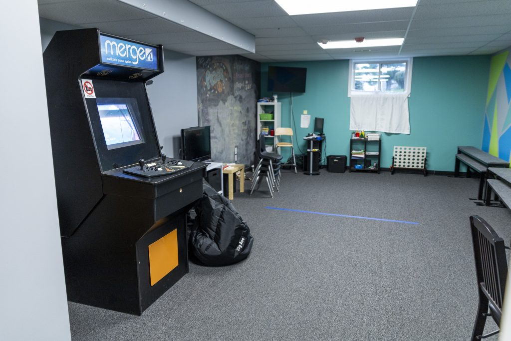 Merge classroom with arcade cabinet and other games
